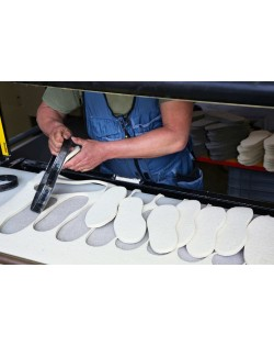 We cut out the slippers soles and heels from our robust fulled felt